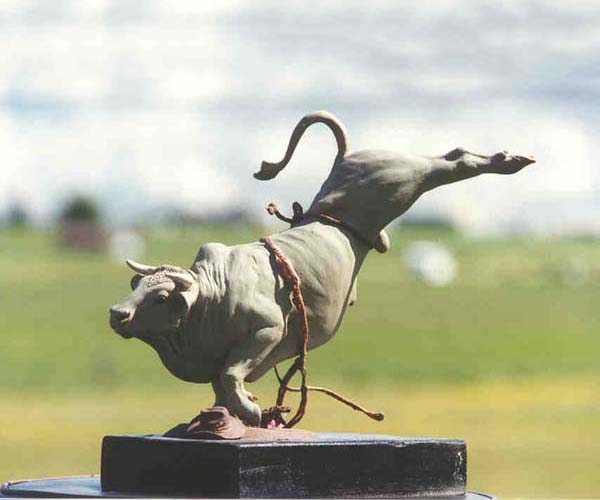 Bull riding bronze sculpture