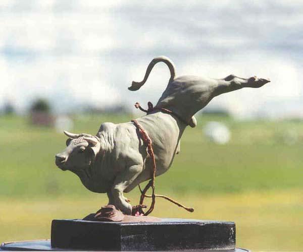 Bull riding bronze sculpture