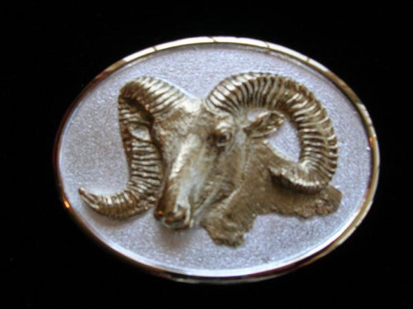 https://www.donbeckbronzes.com/wp-content/uploads/2014/12/Bighorn_buckle_Gold_Silver-e1551300340350.jpg
